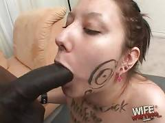 Nasty white slut hungrily works at thick black cock.