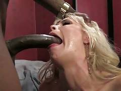 Sexy Mikki Lynn passionately works her mouth at massive black dick.