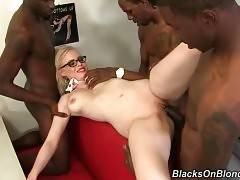 This sexy blonde is fond of group interracial fucking.